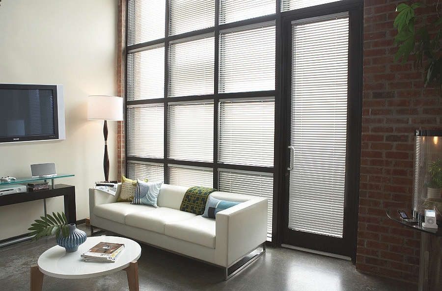brick walls give the masculine living room a classic timeless appeal from blinds - Masculine Living Room