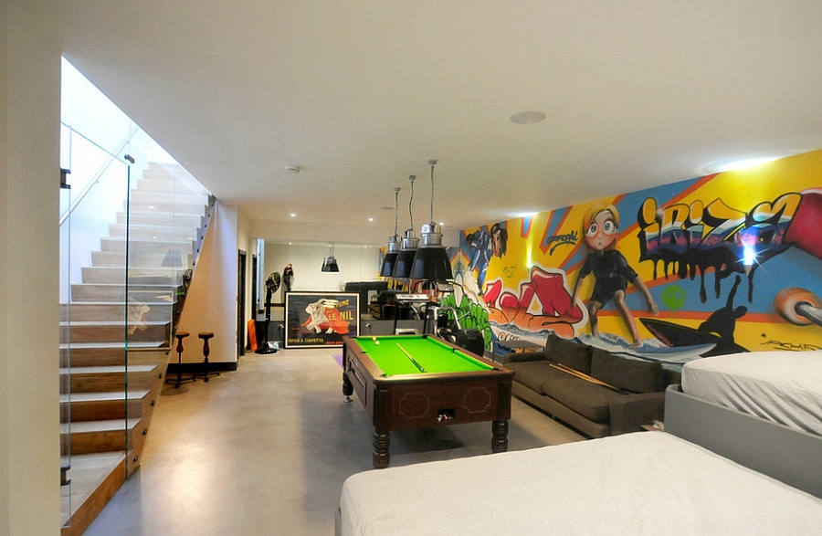 Bright and colorful graffiti in the chic contemporary basement [Design: Riach Architects]
