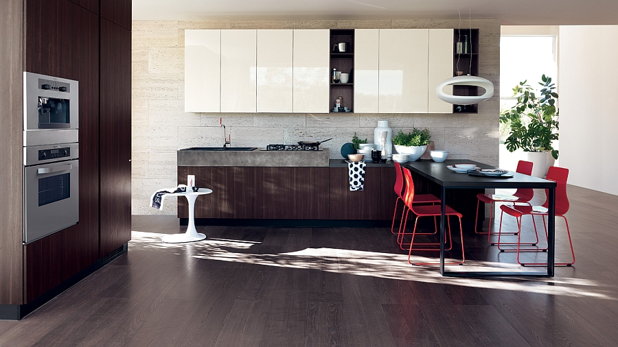 Bright pops of red add color to the modern kitchen