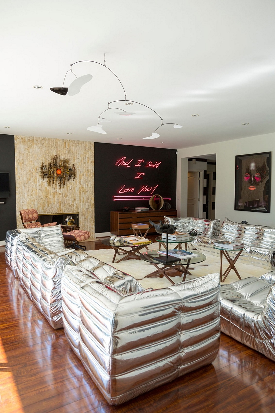 Bright silver sofas add glittering elegance to the living room