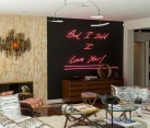Brilliant neon sign on the living room wall steals the show