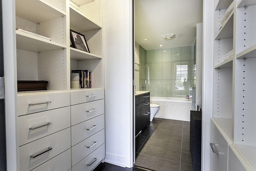 Built-in customized closets & organizers next to the bath