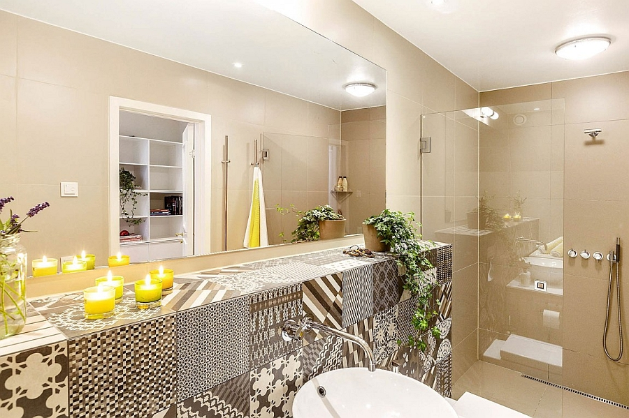 Candles add a sense of relaxed elegance to the modern bath space
