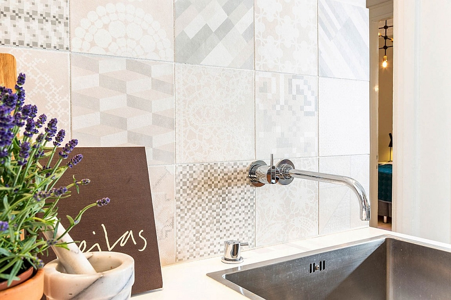 Charming tiled backsplash adds pattern to the kitchen
