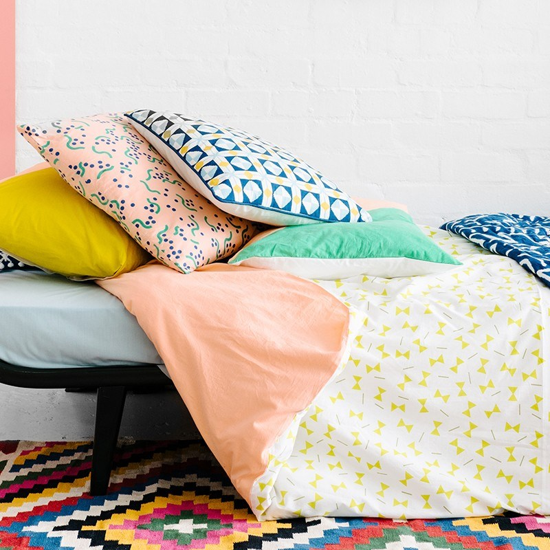 Chartreuse and peach bedding from Arro Home