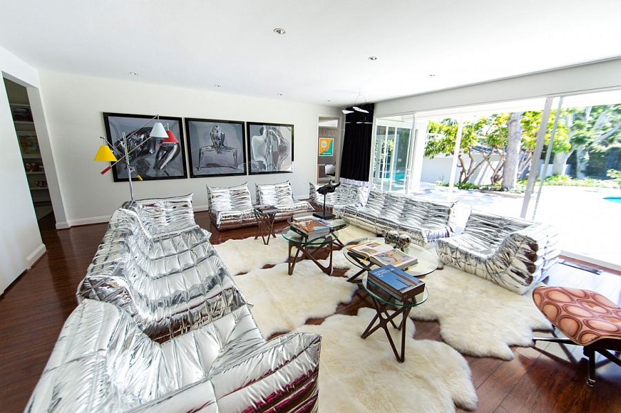 Chic silver sofas and plush rugs bring in the Hollywood Regency charm