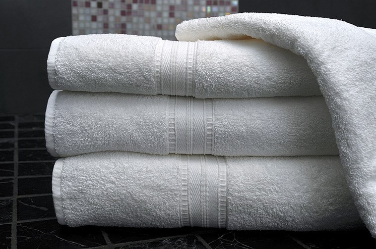 Clean white towels in a modern bathroom