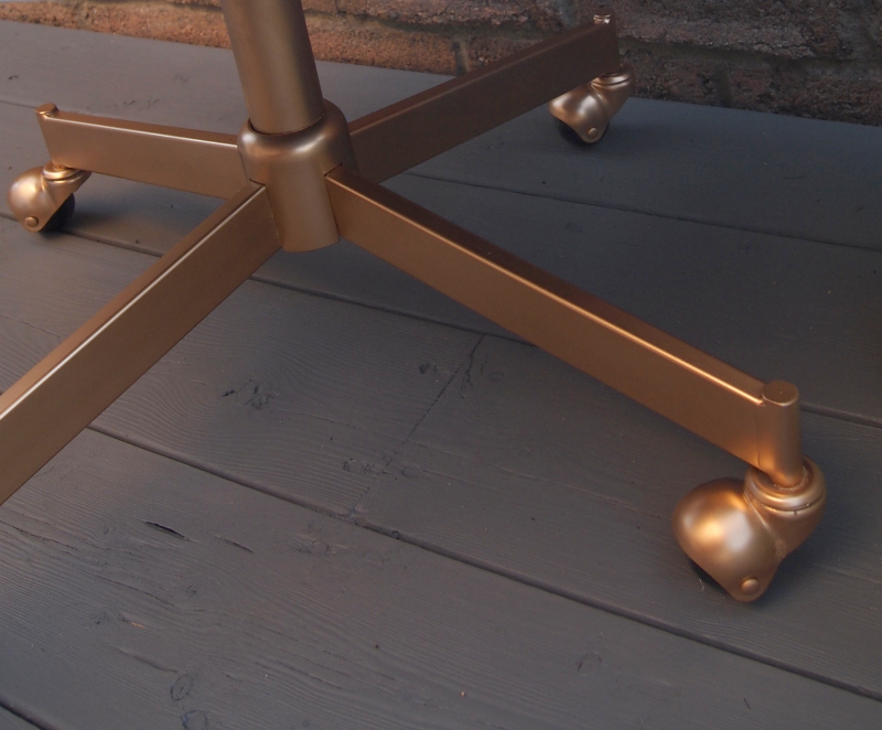 Closeup of the gold base of the leather chair