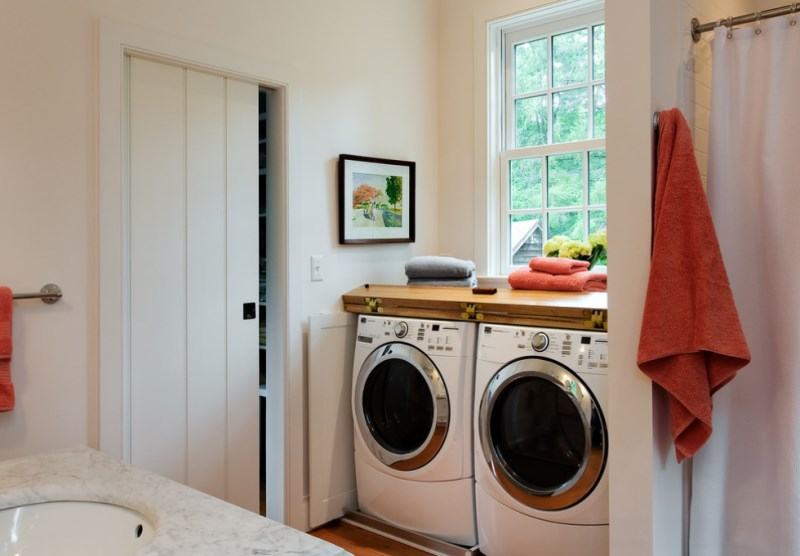 Colorful towels in a modern laundry room