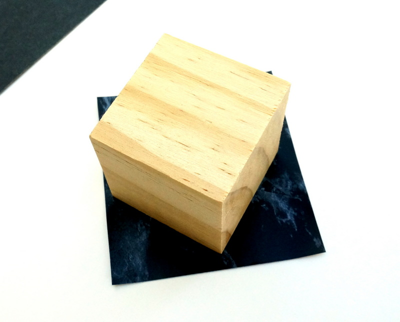 Contact paper and a wooden cube