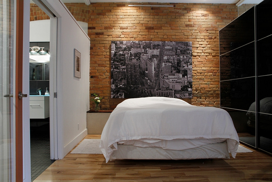 Contrasting black and white surfaces with a brick wall backdrop [Design: Esther Hershcovich]