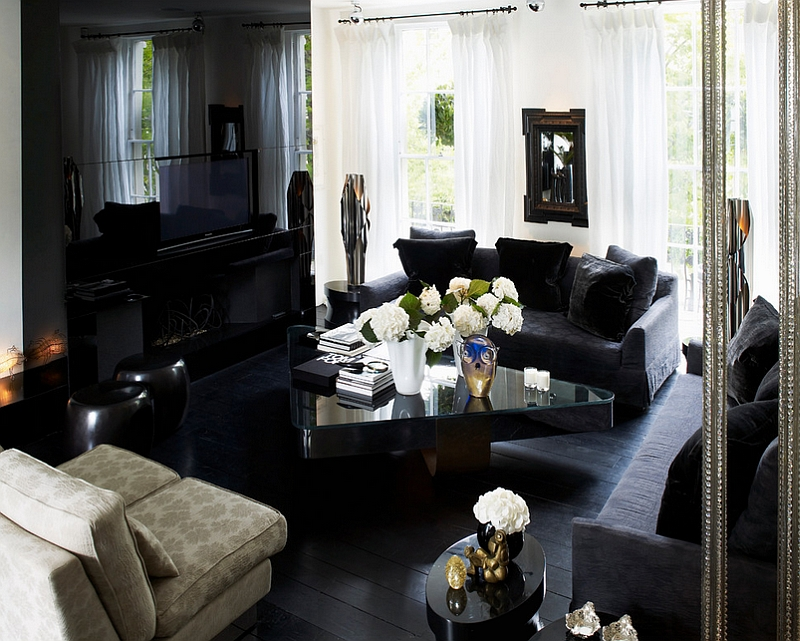 Cozy and elegant living room with dark hardwood floor [Design: Kelly Hoppen London]