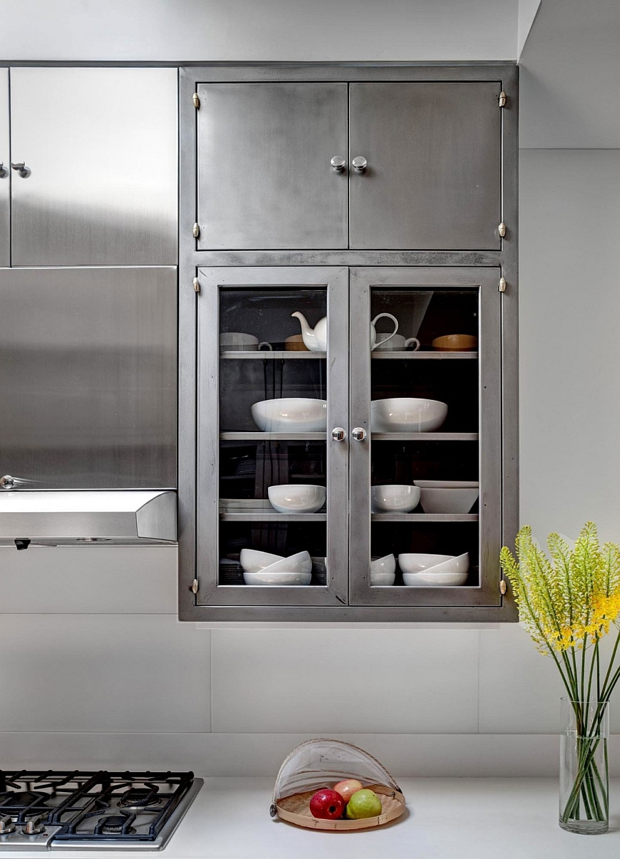 Create a lovely display in teh kitchen with glass door cabinets