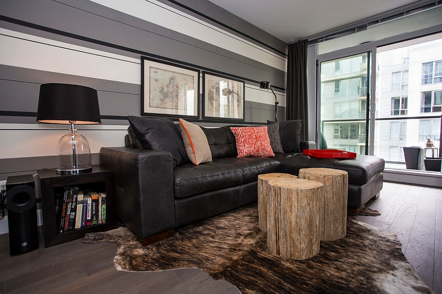 Custom made tree trunk coffee tables add rustic charm to the room [Design: Beyond Beige Interior]