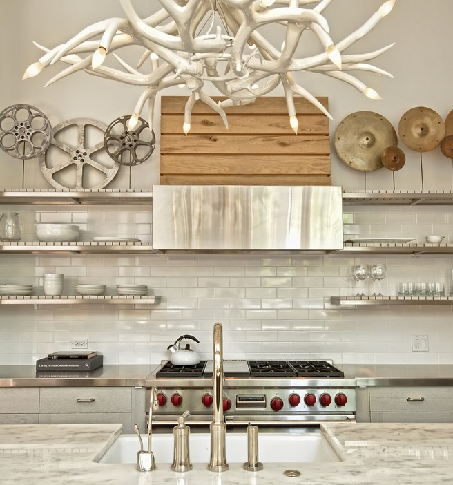 Custom stainless steel open shelving in a contemporary kitchen