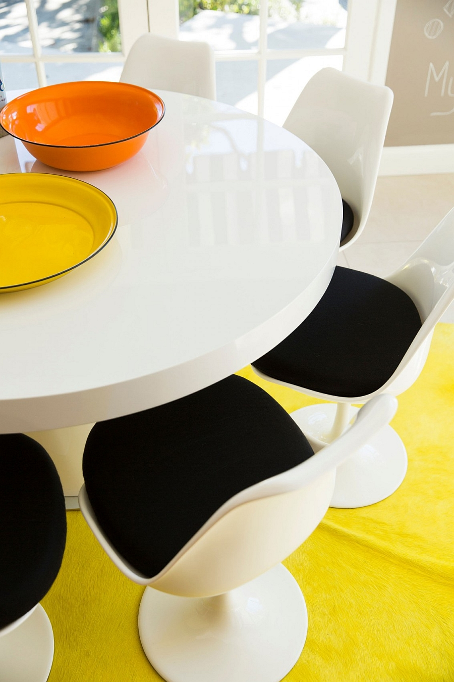 Dining table and chairs inspired by the iconic Tulip Design