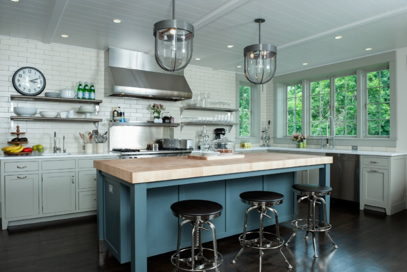 Dishes and glassware on stainless steel kitchen shelving