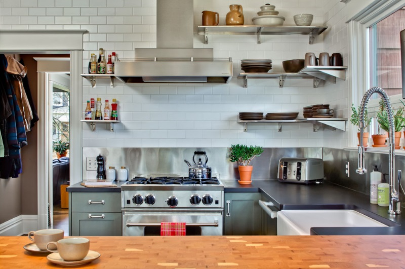 Eclectc kitchen with stainless steel corner shelving