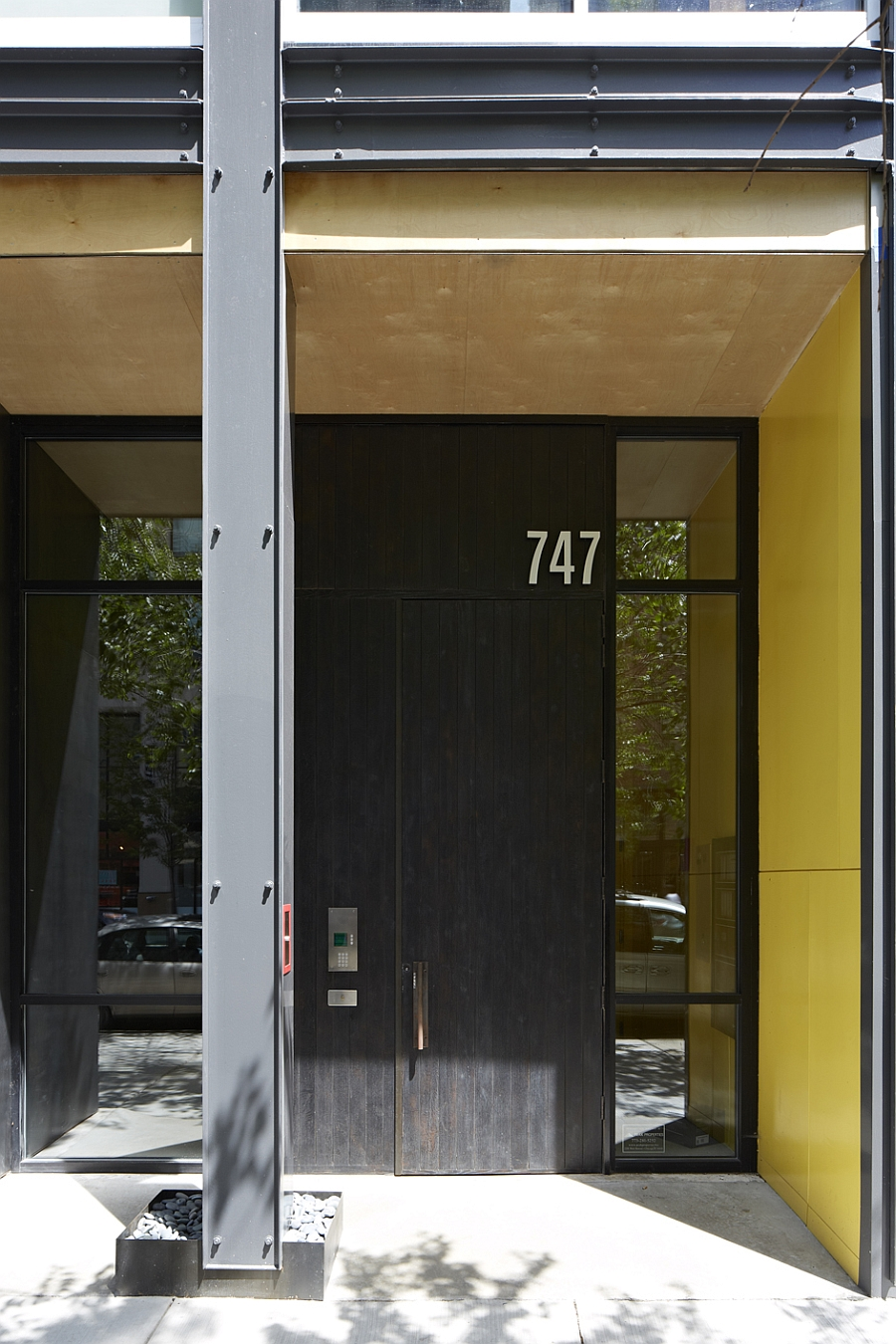 Entrance of 747 North Clark with a charred oak door