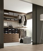 Exclusive walk-in closet design from Jesse with sliding black doors