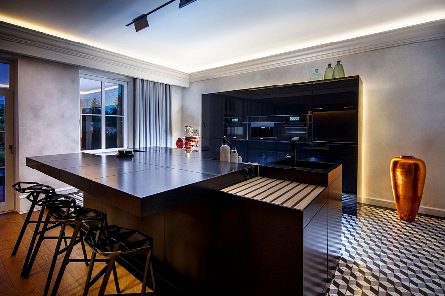 Exquisite contemporary kitchen with a smart breakfast area