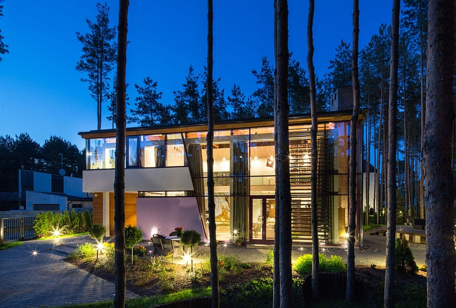 Exterior gardens and pathways add sparkling style to the beautiful villa