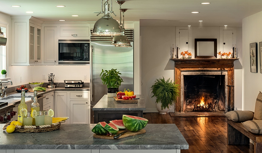 Farmhouse style kitchen with a lovely fireplace [Design: Crisp Architects]
