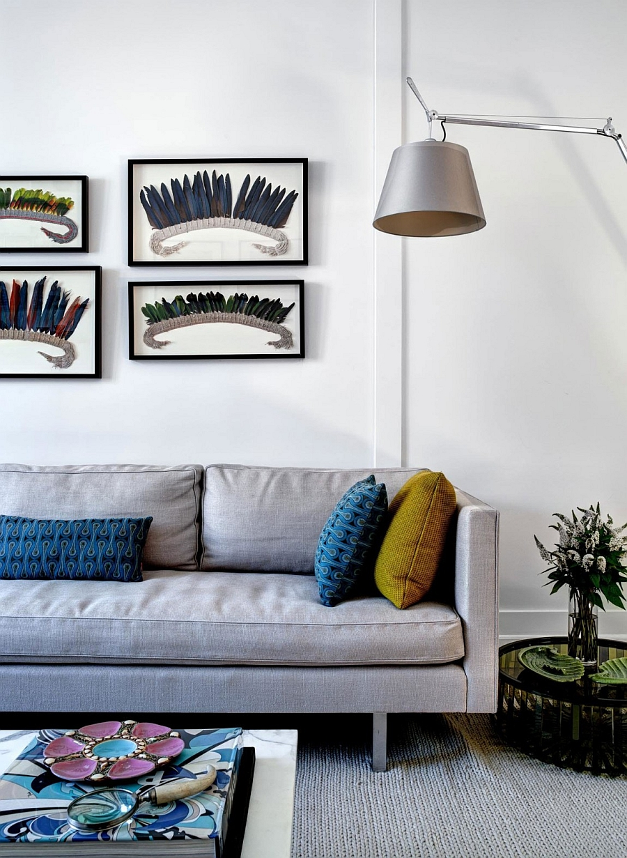 Framed wall art and accent pillows bring dashing color to the living room