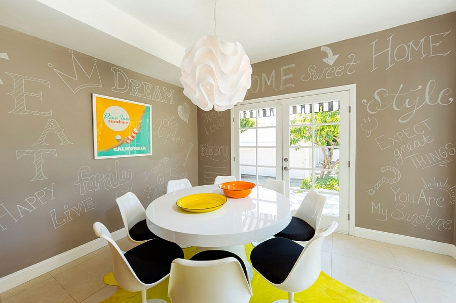 Fun pops of yellow and orange enliven the mid century modern dining