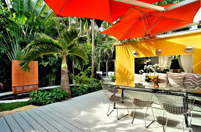 Garden room with bright orange and red accents