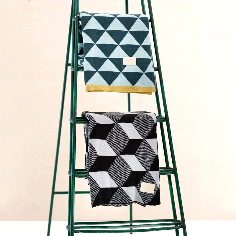 Geometric throws from Ferm Living 12 Bedroom Accessories That Make A Stylish Impact