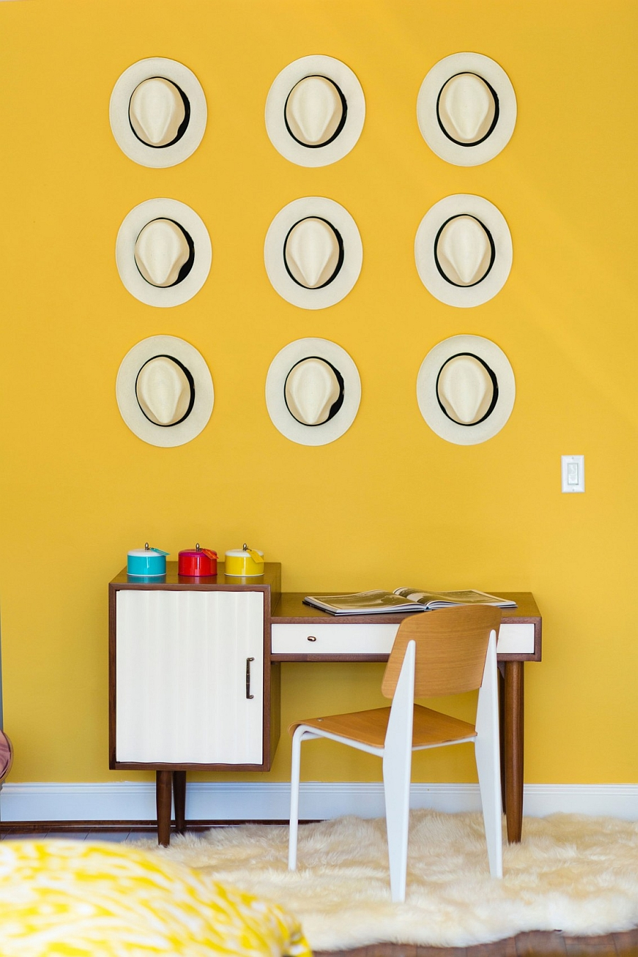 Home office with a collection of decorative hats on the wall