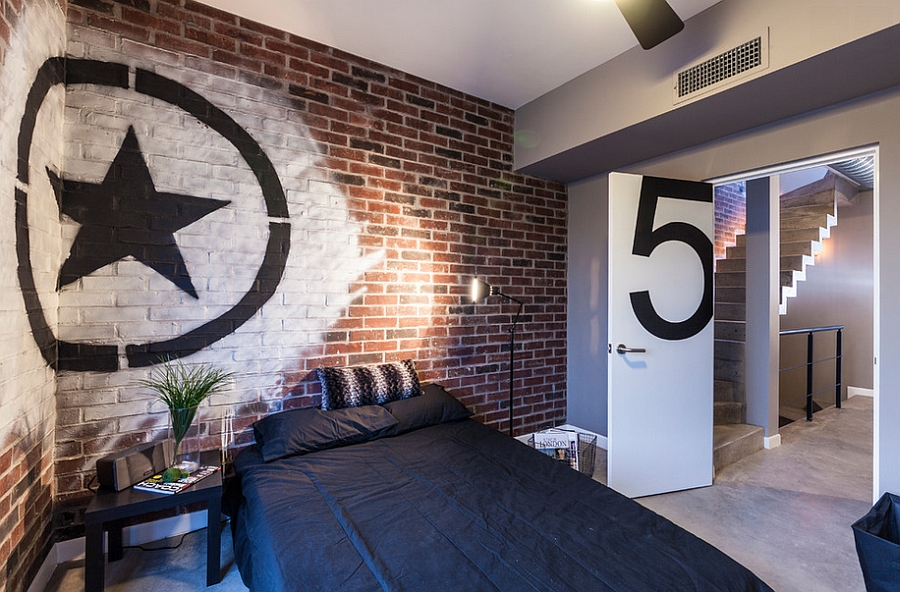 Industrial style bedroom with brick wall and trendy graffiti art Graffiti Brings Spirited Street Style Indoors With Creative, Colorful Flair