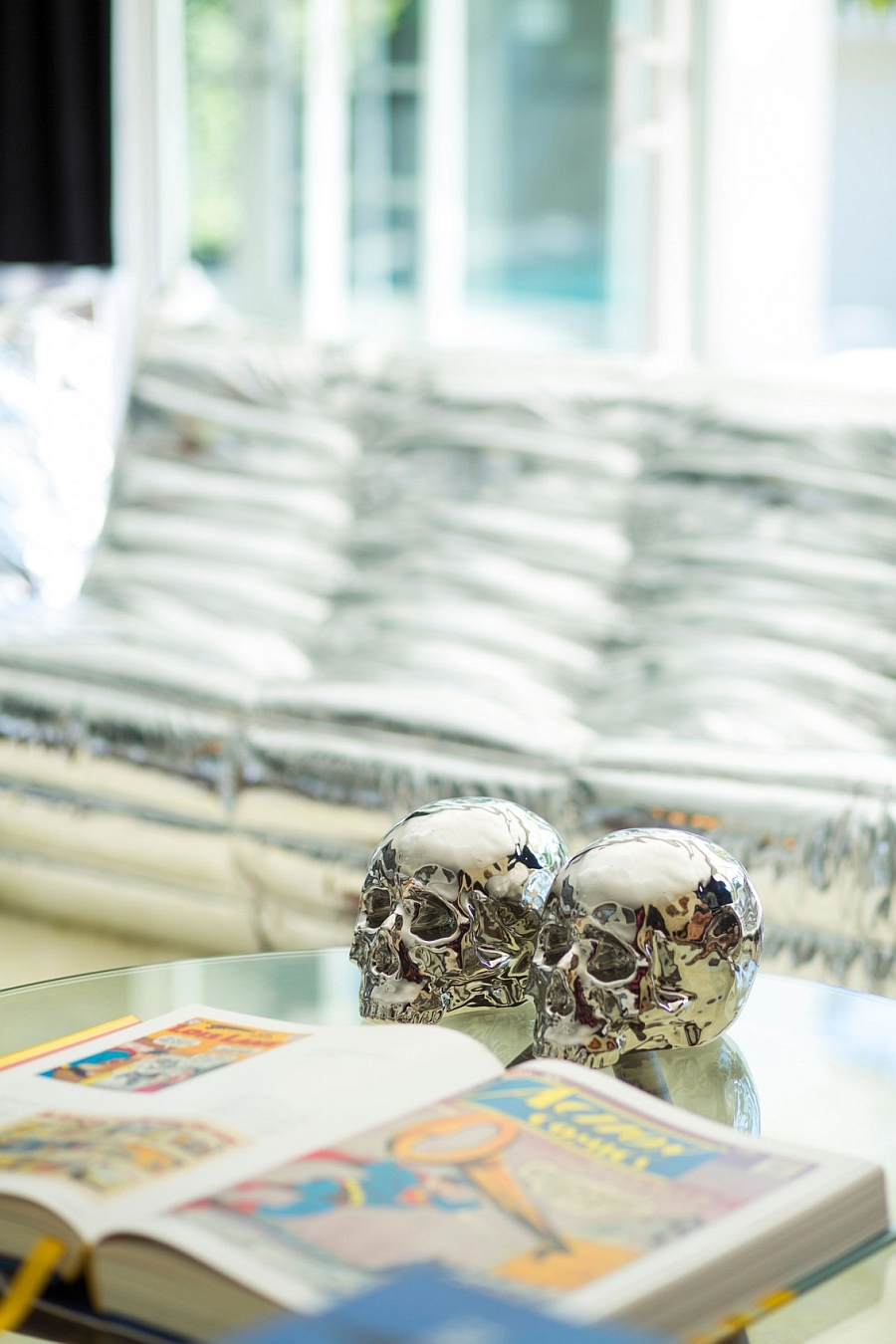 Interesting silver metallic skulls on the living room coffee table!