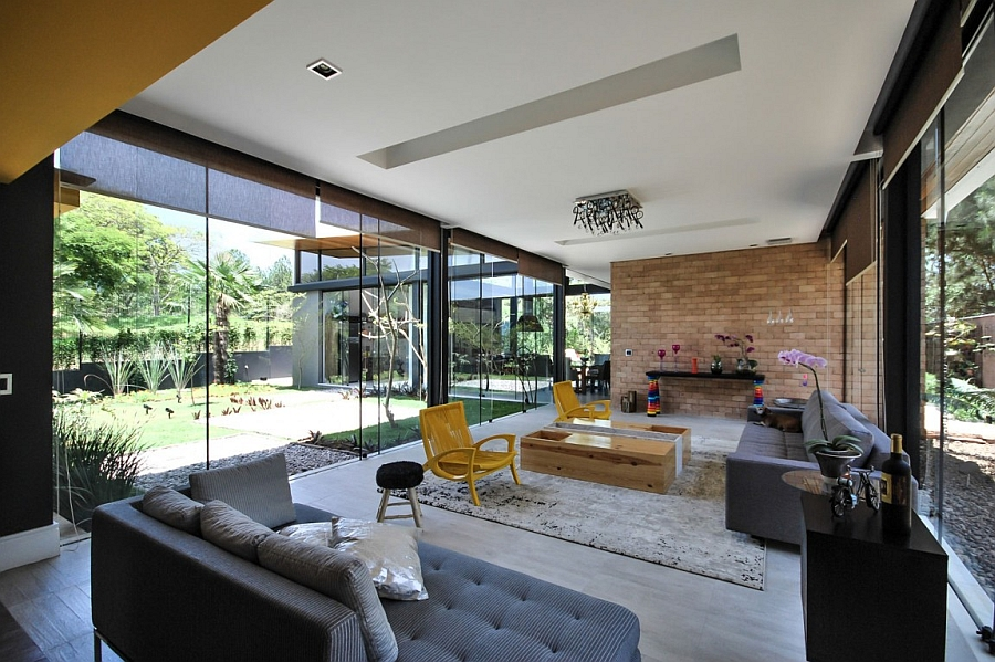 Large glass doors and walls blur the line between the indoors and the outdoors