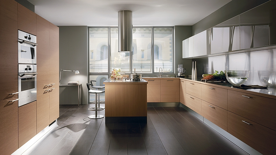 Light oak finish of the cabinets lets the metallic elements of the kitchen stand out