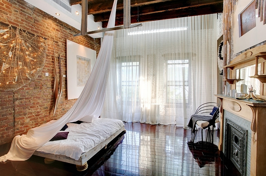 Loft Style Bedroom With High Ceiling Wooden Beams And Low Slung Decor