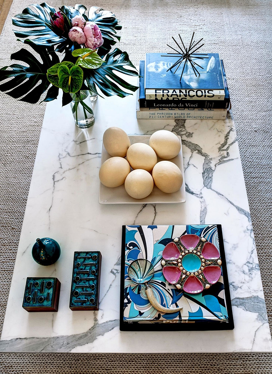 Marble coffee table and accessories that bring the wild charm of Brazil indoors