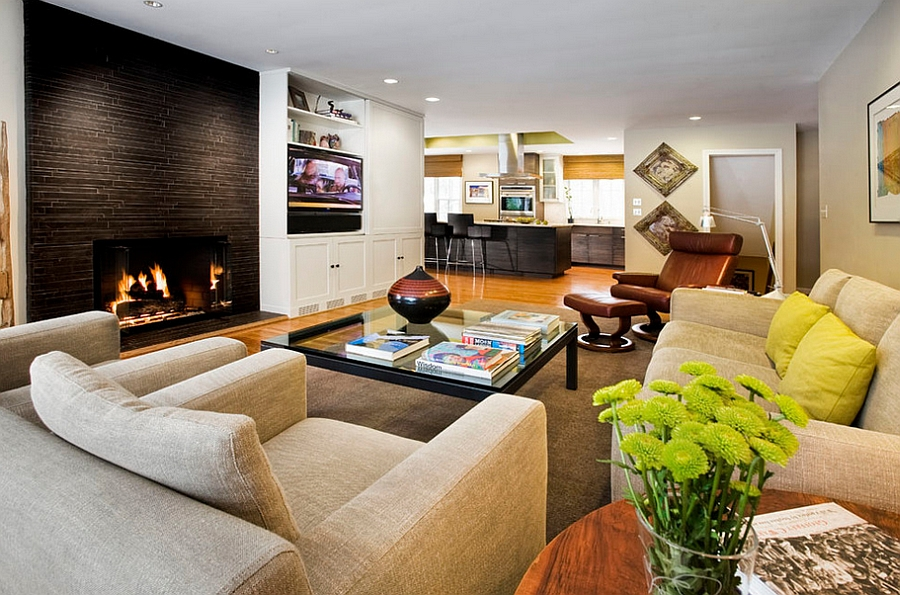 Masculine living space with a gorgeous fireplace at its heart [By: Pavilack Design]