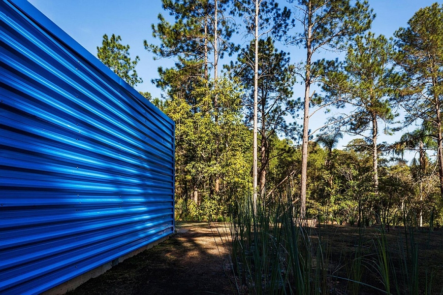 Metal exterior of the summer retreat gives it a distinct look