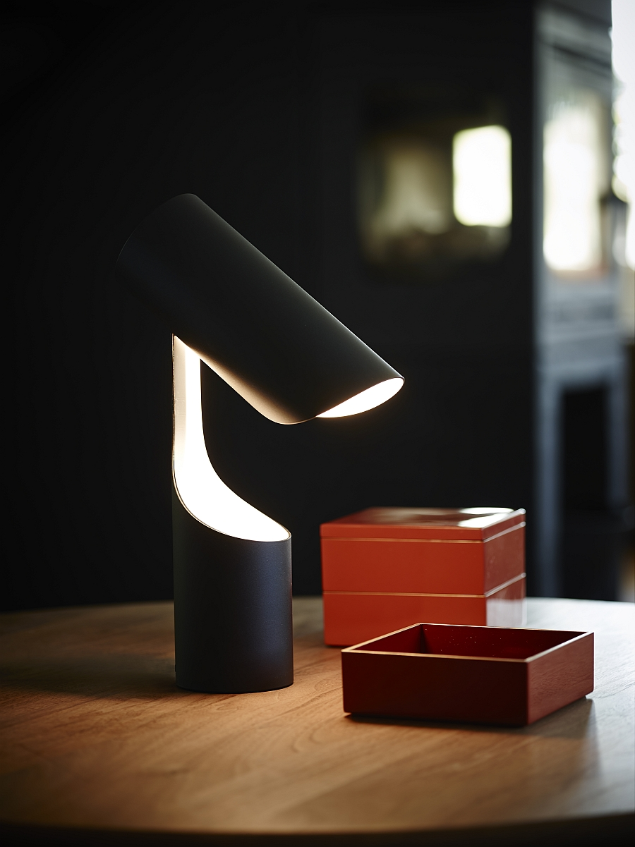 Minimalist table lamp from Le Klint offers focused lighting