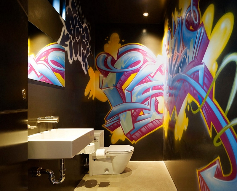 Modern powder room with bold and brilliant graffiti on the walls [By Gary Hutton Design]