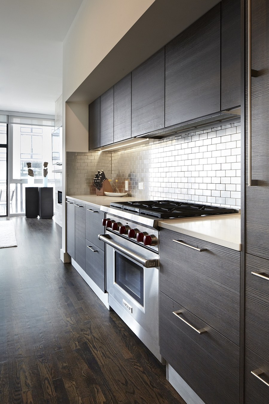 Modern, sleek kitchen of the Chicago home with tile backsplash