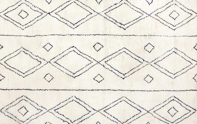 Navy and white diamond-pattern rug
