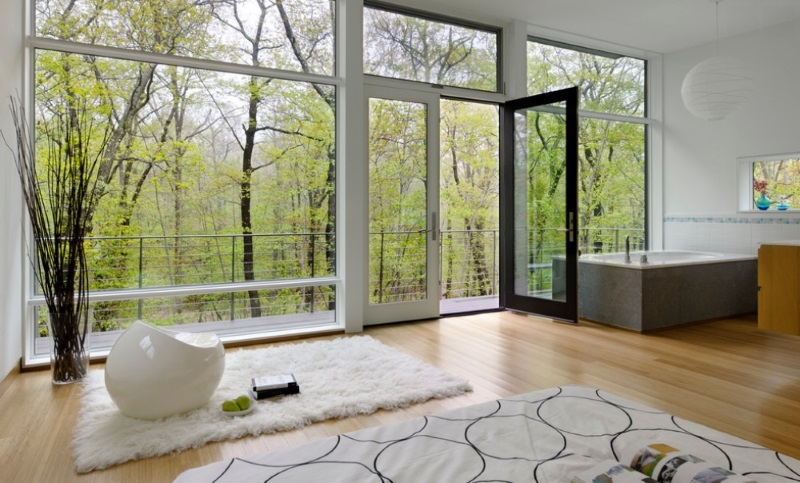 New York bedroom with a wooded view