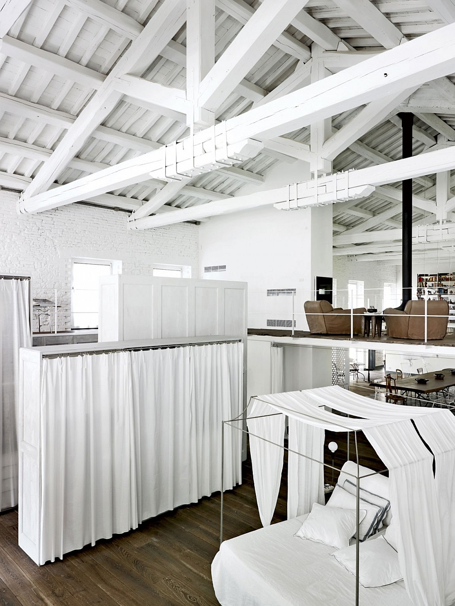 Old Italian factory transformed into a unique industrial style home {Explore this Paola Navone renovation]