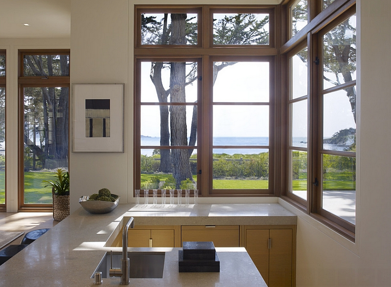 Opening up the kitchen to the view outside with corner windows [Design: Pacific Peninsula Group]