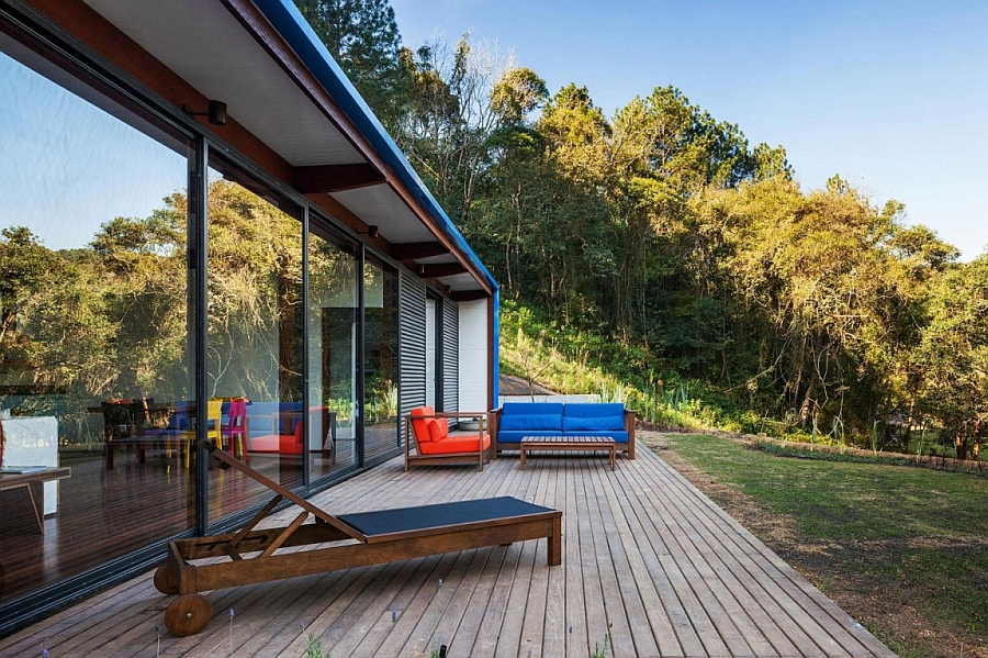 Outdoor deck area of the holiday home with a view of the surrounding landscape