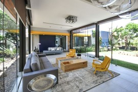 Pops of yellow and blue enliven the spacious living area