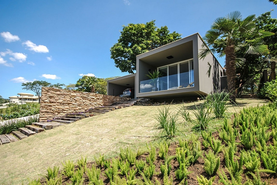Private street facade of House ME in Brazil Serene Sao Paulo Residence Offers An Enchanting Escape With Scenic Backdrop!